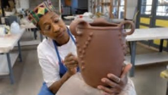 Amanda Swimmer creates a pot at Cherokee Heritage Festival in Hayesville