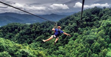 ziplining with mountains in the background