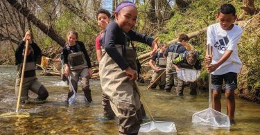 Koontz Intermediate School students at Cane Creek. Photo courtesy of RiverLink