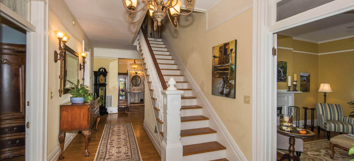 Main staircase and sitting room at right