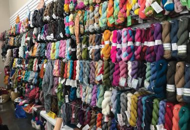 Wall of yarn in the store