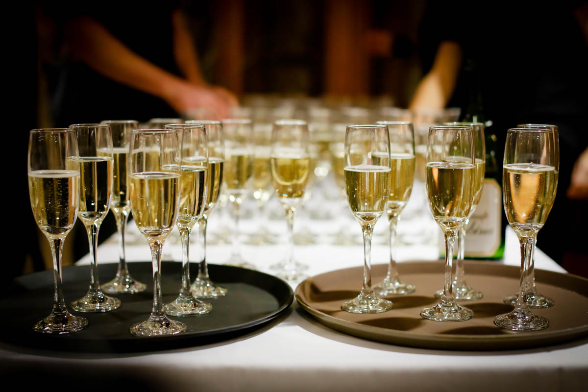 two trays of champagne glasses